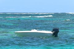 Small motor boat sailing on the big turquoise ocean with waves. Royalty Free Stock Photos