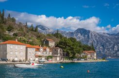 Private motorboat on the shore in Perast town. Small motor boat on the shore in the beautiful Perast town in the Kotor Bay, Montenegro royalty free stock image