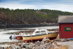 Small motor boats on the coast in Norway Royalty Free Stock Photo