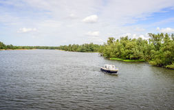 Small motor yacht sailing in a large Dutch nature reserve Royalty Free Stock Photos
