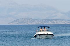 Small motor yacht sailing on Mediterenian sea Royalty Free Stock Photos