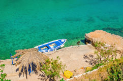 Small motorbat docked in peaceful bay. Greece Stock Photo