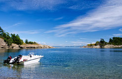 Small motorboat at anchor. Boat at anchor, San Juan Islands, Washington, USA stock images