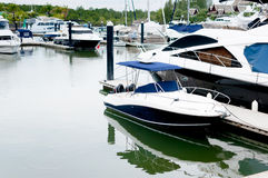 Small motorboat docking at a harbour Royalty Free Stock Photography