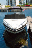 Small motorboat in marina. Boat on a sunny summer day in Hellerup, a suburb of Copenhagen, Denmark stock photography