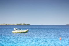 Small motorboat moored in a clean warm sea, Croatia Dalmatia Stock Photography