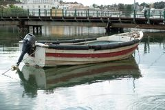 Small motorboat moored in the river crossing the city. The left bank is Tavira Santa Maria. On this bank are especially the residential side of the city and royalty free stock photography