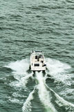 Small motorboat navigate in Saint Laurent river Stock Photo
