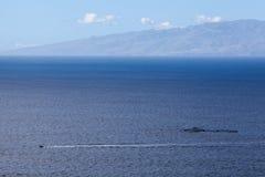Small motorboat passing across Atlantic ocean. The La Gomera island on horizon, aerial view, Tenerife, Canary islands, Spain Royalty Free Stock Photo