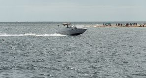 Motorboat in the ocean. Small motorboat during a sunny day around Provincetown, MA, Boston stock image