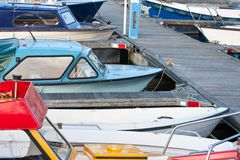 Small motorboats in a Dutch harbor Stock Photo