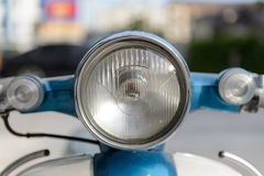 Small motorcycle headlight and turn signal, isolated, close up Stock Photography