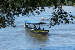 Small motorized boat on the Napo river in Ecuador. June 6, 2017 Misahualli, Ecuador:  motorized small boats are used as a main transportation on river Napo in Royalty Free Stock Images
