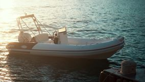 Small motorized boat and sea at sundown. Small rescue motorized boat and sea at sundown stock video footage