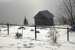 Small mountain cabin at winter Stock Photography