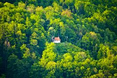 Small mountain chapel in the woods of Bavaria royalty free stock image