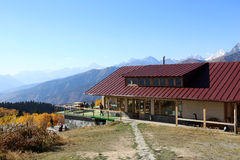 Small mountain hotel with a beautiful autumn view. Small mountain hotel with a beautiful golden autumn forest view in Caucasus mountain, Svaneti, Georgia, Europe Stock Image