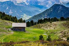Small mountain hut. A small mountain hut surrounded by grassland Stock Images