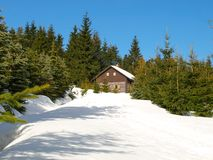 Small mountain hut in winter time stock images