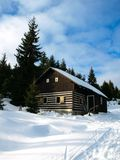 Small mountain hut in winter time Stock Image