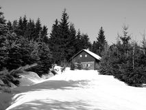Small mountain hut in winter time Stock Photos