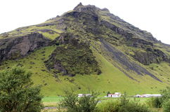 Small Mountain in Iceland. Iceland`s green interior features many mountainous areas with outcrops of volcanic rock Royalty Free Stock Photography