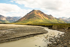 Small mountain and river inside Denali National Preserve Royalty Free Stock Image