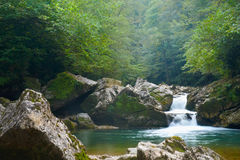 Small mountain river waterfall. Evening mist Stock Photos