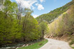 Small mountain road and river Royalty Free Stock Image