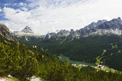 Small Mountain Town of Italy. The small tourist town of Missurina in northern Italy as seen from above along the mountainsides of the Dolomite Mountains Stock Photography
