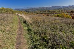 A small mountain trail crosses a peak in the Smokies in early fall. Royalty Free Stock Photography