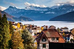 Small Mountain Village And Snowy Peaks Of Alps In The Background Royalty Free Stock Photos