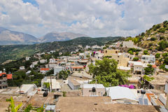 Small mountain village. Panorama with small village and mountains in Crete Royalty Free Stock Photography