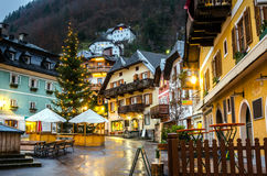 Small Mountain Village on a Rainy Night. Night View of a Small Mountain Village in the Austrian Alps with Christmas Decorations Royalty Free Stock Photos