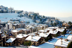 Small Mountain Village. Small mountain village and ski resort in the middle of winter Royalty Free Stock Photo