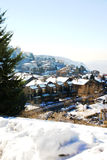 Small Mountain Village. Small mountain village and ski resort in the middle of winter Stock Image