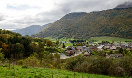 Small mountain village under a cloudy sky Stock Image
