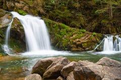 Small Mountain Waterfall . Stock Photo