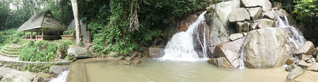 Small mountain waterfall on the rocks and cozy alcove foe relax in the tropical forest Stock Photography