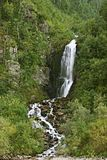 Small mountain waterfall by summer Royalty Free Stock Images