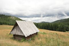 Small mountain wooden hut Royalty Free Stock Images