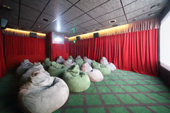 Small movie theater with comfortable green unusual seats Royalty Free Stock Photography