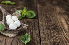 Small Mozzarella Balls (on Wooden Background) Royalty Free Stock Images