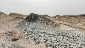 A small mud volcano stock photos