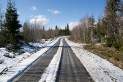 Small muddy road. Sunny day, overlooking a small muddy road with snow on Royalty Free Stock Photo
