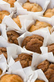 Small muffin cakes in rows Royalty Free Stock Photography