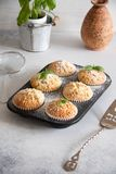 Small muffins with lemon and basil. Perfect vegetarian dessert: Small muffins with lemon and basil stock images