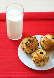 Small muffins on plate and glass Royalty Free Stock Photography