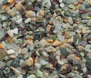 Small multi-coloured stones. Texture of multi-coloured natural stones stock photography
