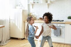 Free Small Multi Ethnic Girls Holding Hands Play In Kitchen Royalty Free Stock Image - 186899226